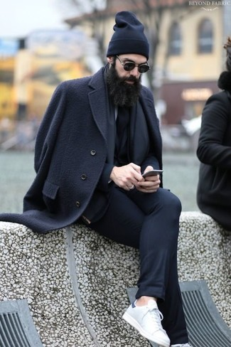 How to wear: black overcoat, black suit, white leather low top sneakers, black beanie