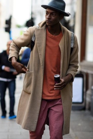 How to wear: beige overcoat, orange sweatshirt, red chinos, grey leather backpack