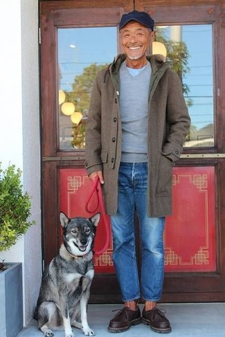 How to wear: olive overcoat, grey v-neck sweater, light blue crew-neck t-shirt, blue jeans