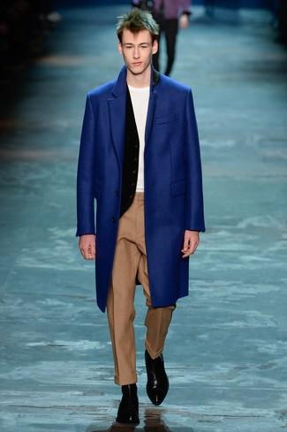 How to wear: blue overcoat, black waistcoat, white crew-neck t-shirt, khaki wool dress pants