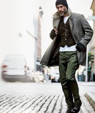 How to wear: grey herringbone overcoat, dark brown velvet waistcoat, white crew-neck t-shirt, olive cargo pants