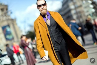 How to wear: mustard overcoat, black waistcoat, violet dress shirt, black dress pants