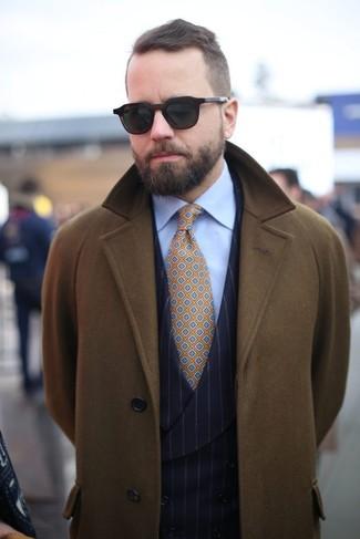How to wear: olive overcoat, black vertical striped waistcoat, light blue dress shirt, mustard print tie