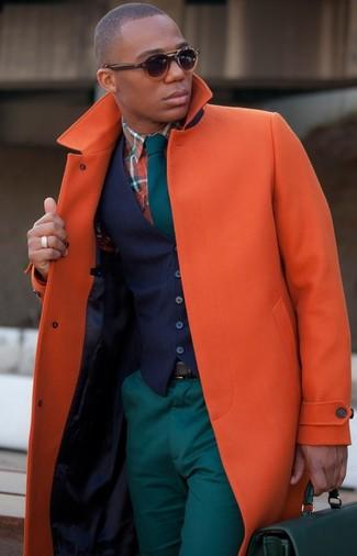 How to wear: orange overcoat, navy waistcoat, orange plaid long sleeve shirt, teal chinos