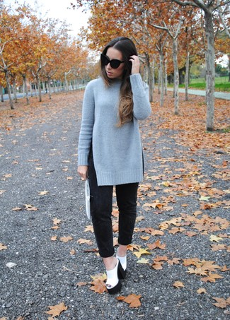 A charcoal knit oversized sweater and black boyfriend jeans will convey a carefree, cool-girl vibe. White and black chunky leather heeled sandals will add a touch of polish to an otherwise low-key look.
