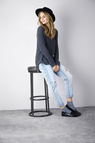 Make a dark grey knit oversized sweater and light blue distressed boyfriend jeans your outfit choice for an unexpectedly cool ensemble. Why not introduce black leather loafers to the mix for an added touch of style?