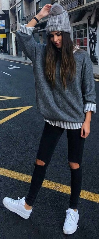 Reach for a grey oversized sweater and a grey beanie for a relaxed take on day-to-day wear. White leather low top sneakers look amazing here. This outfit is our idea of perfection for those warmer days of spring.
