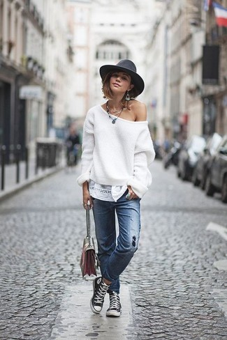 How to wear: white oversized sweater, blue ripped jeans, black and white canvas high top sneakers, multi colored leather crossbody bag