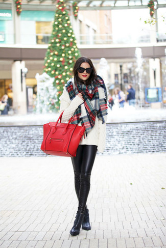 How to wear: white knit oversized sweater, black leather leggings, black leather ankle boots, red leather tote bag