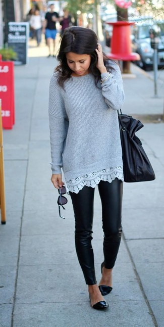 Make a dark grey knit oversized sweater and black leather leggings your outfit choice for a lazy Sunday brunch. Take a classic approach with the footwear and grab a pair of black leather ballet flats.