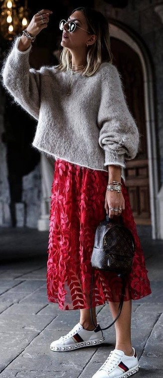 How to wear: grey mohair oversized sweater, red floral tulle midi skirt, white embellished leather low top sneakers, dark brown print leather backpack