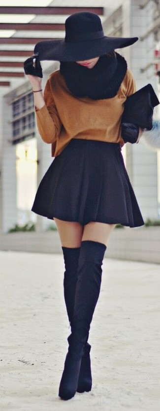 How to wear: tobacco oversized sweater, black skater skirt, black suede over the knee boots, black fur clutch