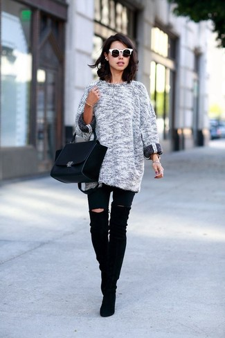 Consider pairing a charcoal knit oversized sweater with black ripped skinny jeans for a casual-cool vibe. Black suede over the knee boots will bring a classic aesthetic to the ensemble.