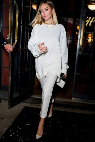 How to wear: white oversized sweater, white skinny pants, white leather pumps, white leather clutch