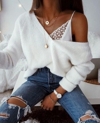 How to wear: white knit oversized sweater, white lace tank, blue ripped jeans, gold pendant