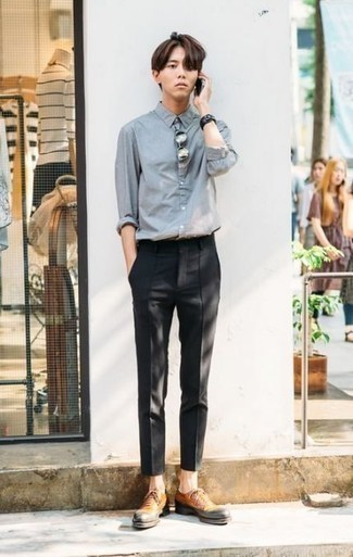 How to Wear Tan Leather Oxford Shoes: Why not wear a light blue chambray long sleeve shirt with black chinos? Both of these items are very practical and look nice worn together. Play down the casualness of your look by slipping into a pair of tan leather oxford shoes.