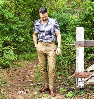 How to wear: beige leather watch, brown leather oxford shoes, khaki chinos, navy and white vertical striped short sleeve shirt