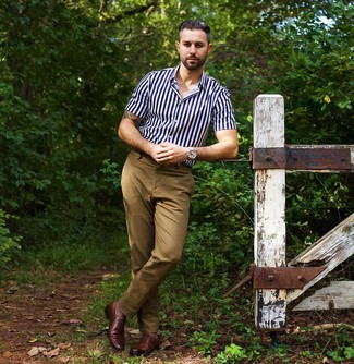 How to wear: silver watch, brown leather oxford shoes, khaki chinos, navy and white vertical striped short sleeve shirt