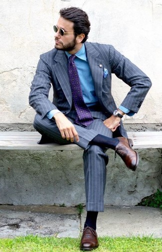 How to wear: purple print tie, brown leather oxford shoes, blue denim shirt, grey vertical striped suit