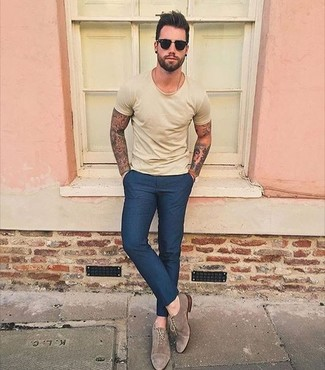 How to wear: black sunglasses, brown suede oxford shoes, navy dress pants, yellow crew-neck t-shirt