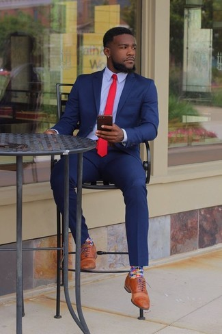 How to wear: red tie, tan leather oxford shoes, light blue dress shirt, blue suit