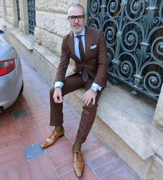 How to wear: dark brown polka dot tie, tan leather oxford shoes, light blue dress shirt, dark brown suit