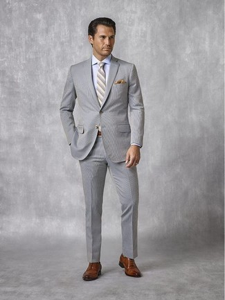 How to wear: grey horizontal striped tie, brown leather oxford shoes, light blue dress shirt, grey seersucker suit