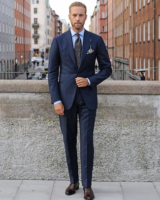 How to wear: black polka dot tie, burgundy leather oxford shoes, light blue dress shirt, navy suit