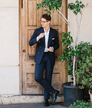 How to wear: white pocket square, black leather oxford shoes, white dress shirt, navy vertical striped suit