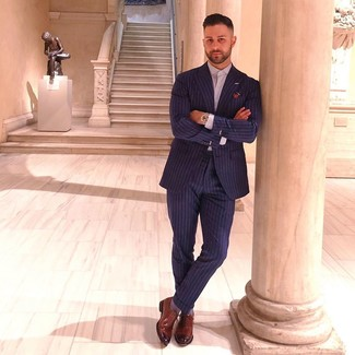 How to wear: multi colored print pocket square, brown leather oxford shoes, light violet dress shirt, navy vertical striped suit