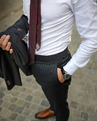 How to wear: burgundy print tie, brown leather oxford shoes, white dress shirt, charcoal vertical striped suit