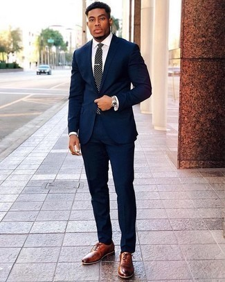 How to Wear a Navy and White Horizontal Striped Tie For Men: Go all out in a navy suit and a navy and white horizontal striped tie. And if you wish to immediately play down this outfit with a pair of shoes, why not add a pair of tobacco leather oxford shoes to the mix?