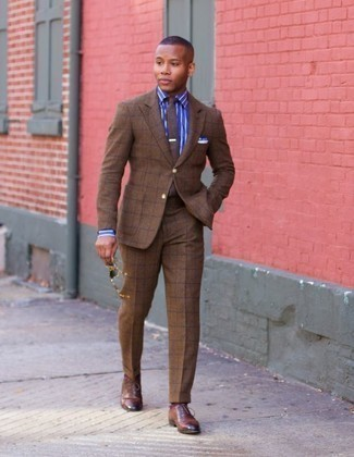 How to Wear a Brown Check Suit: This pairing of a brown check suit and a blue vertical striped dress shirt is incredibly dapper and provides a clean and chic look. You could perhaps get a bit experimental on the shoe front and add brown leather oxford shoes to the mix.