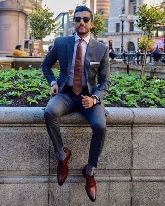 How to Wear a Charcoal Check Suit: A charcoal check suit and a white dress shirt are definitely worth adding to your list of indispensable menswear styles. Our favorite of a multitude of ways to finish this look is with a pair of tobacco leather oxford shoes.