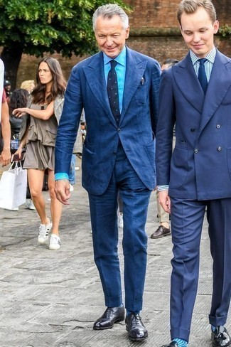 How to Wear a Blue Dress Shirt For Men: Pair a blue dress shirt with a navy suit if you're going for a proper, stylish outfit. When in doubt about what to wear on the footwear front, stick to a pair of black leather oxford shoes.