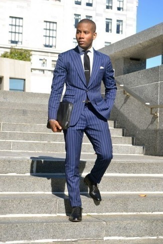 How to Wear a Blue Vertical Striped Suit: The sartorial collection of any discerning gent should always include such must-haves as a blue vertical striped suit and a white dress shirt. Complement your ensemble with a pair of black leather oxford shoes and off you go looking awesome.