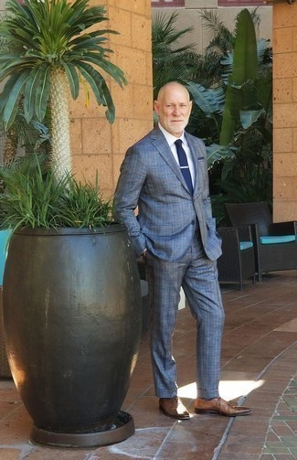 How to Wear a Navy Pocket Square: Infuse variation into your daily casual collection with a blue plaid suit and a navy pocket square. Rounding off with a pair of brown leather oxford shoes is a simple way to introduce a bit of fanciness to this ensemble.