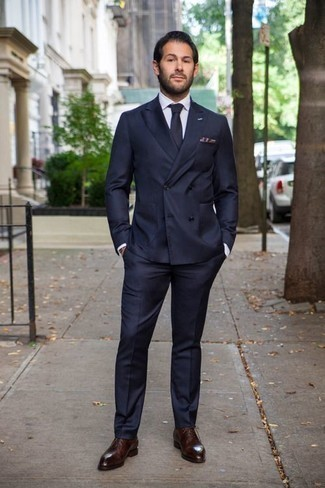 Men's Looks & Outfits: What To Wear In 2020: Combining a navy suit with a white dress shirt is a savvy choice for a sharp and elegant look. If you're wondering how to finish off, a pair of burgundy leather oxford shoes is a savvy option.