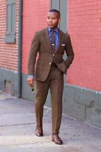 How to Wear a Brown Check Suit: This polished combination of a brown check suit and a blue vertical striped dress shirt is a must-try ensemble for today's gentleman. On the shoe front, go for something on the dressier end of the spectrum by slipping into a pair of brown leather oxford shoes.