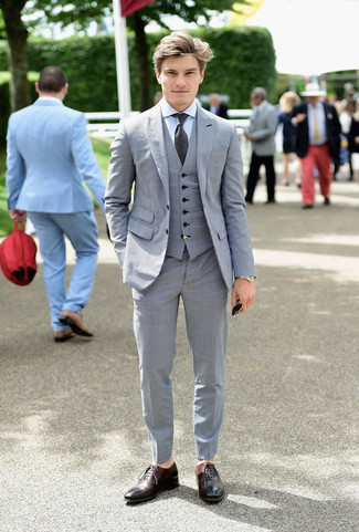 How to wear: charcoal tie, dark brown leather oxford shoes, light blue dress shirt, grey three piece suit