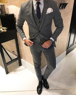 How to wear: navy polka dot tie, black leather oxford shoes, white dress shirt, grey check three piece suit