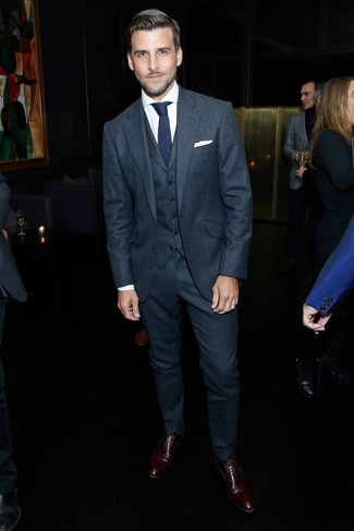 How to wear: navy knit tie, dark brown leather oxford shoes, white dress shirt, charcoal wool three piece suit
