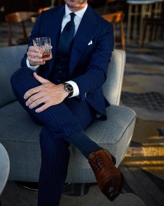 How to Wear Navy Socks For Men: A navy vertical striped three piece suit and navy socks have become indispensable wardrobe styles for most guys. You can take a classic approach with footwear and make brown leather oxford shoes your footwear choice.
