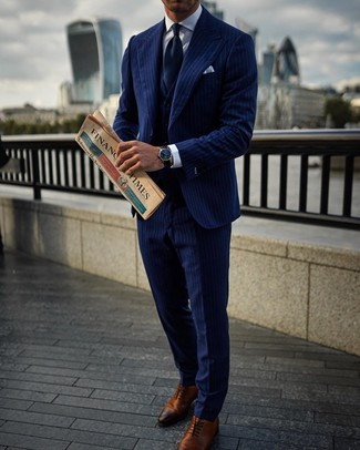 How to wear: navy tie, brown leather oxford shoes, white dress shirt, navy vertical striped three piece suit