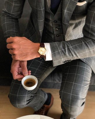 How to wear: navy tie, brown leather oxford shoes, white dress shirt, charcoal check three piece suit