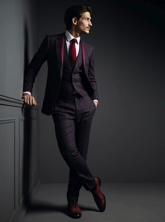 How to Wear a Burgundy Tie For Men: A dark purple wool three piece suit and a burgundy tie are indispensable sartorial weapons in any man's sartorial collection. For times when this outfit appears too dressy, play it down by finishing off with burgundy leather oxford shoes.