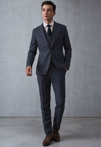 How to Wear a Navy Three Piece Suit: You're looking at the solid proof that a navy three piece suit and a beige vertical striped dress shirt look awesome when worn together in a classy outfit for today's man. Dark brown leather oxford shoes pull the ensemble together.