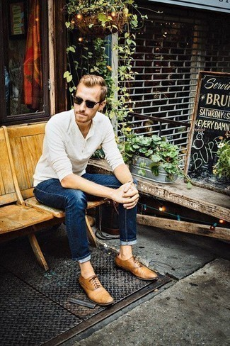 How to Wear Tan Leather Oxford Shoes: Try pairing a white long sleeve henley shirt with navy jeans if you seek to look casually cool without exerting much effort. Finishing off with tan leather oxford shoes is a fail-safe way to inject a hint of class into your getup.