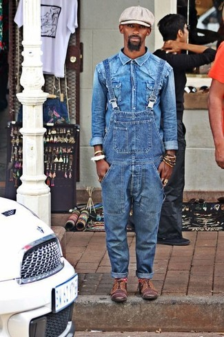 How to wear: grey flat cap, brown leather oxford shoes, blue denim overalls, blue denim shirt