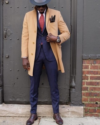 How to wear: charcoal wool hat, dark brown leather oxford shoes, navy vertical striped suit, camel overcoat